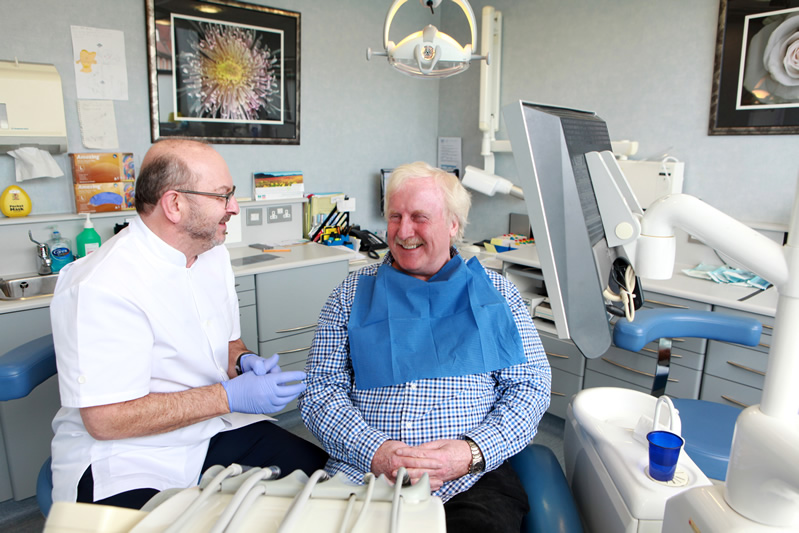 Cosmetic Dentist Jon Portner With Patient